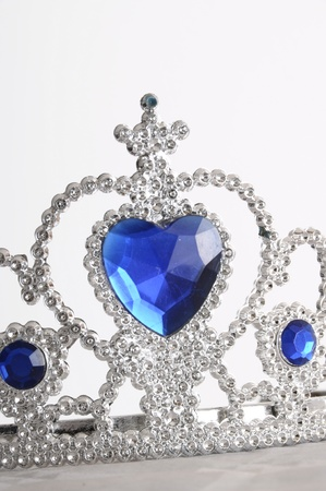 Toy tiara with diamonds and blue gem, like a princess crown photo