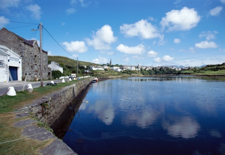 achill: Overview of Bay and village of Clifden, Ireland under blue sky