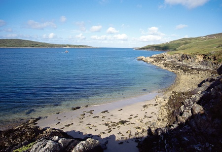 achill: Overview of sand beach under blue sky, in bay of Clifden, Ireland Stock Photo
