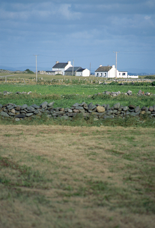 achill: Small white houses in Ireland countryside and view of green fields, Europe