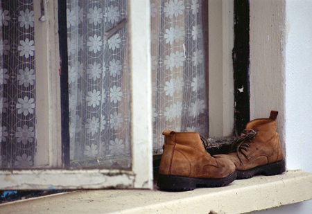 achill: Old Shoes on a window sill in Ireland