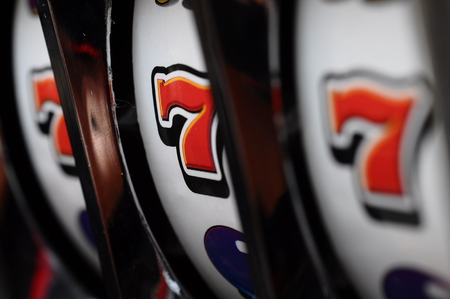Close up of three seven jackpot on a casino slot machine Stock Photo