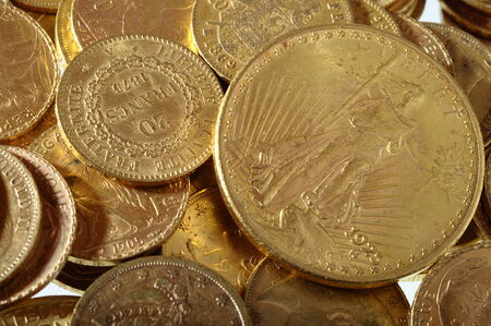 Close up of a stock of Gold french and american coins photo