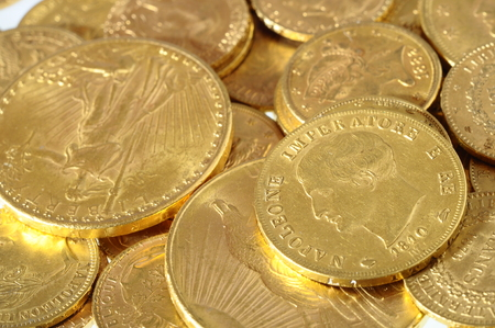 an ounce: Close up of a stock of Gold french and american coins