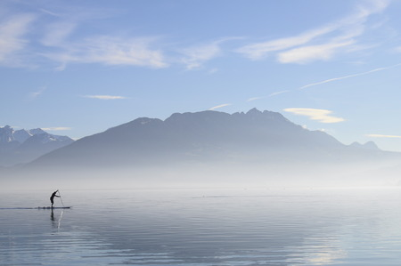 nautic: quiet landscape of lake Annecy in Savoy and paddle man, France