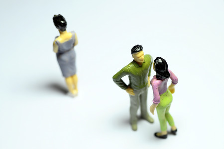 catechism: Miniature Man chatting with woman, and single woman turning back