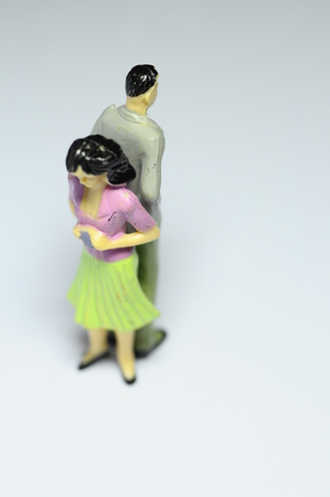 argument from love: Miniature Man and woman turning back like after an argument