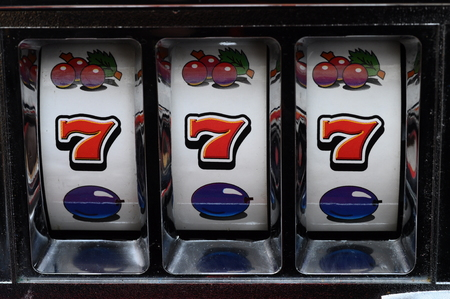 Close up of three seven jackpot was casino slot machines
