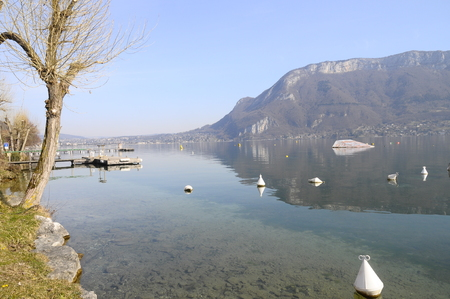 Overview of Lake of Annecy and Forclaz mountain, in France photo