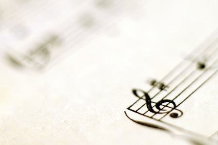 music score: Close up of piano music score and notes and old paper