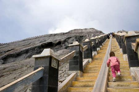 Baby rising stairs on Bromo volcano, Indonesia Stock Photo