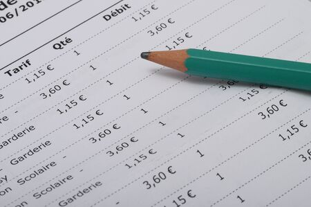 Close up of fees : Nursery and cafeteria school bill listing in France Stock Photo
