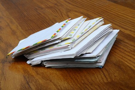 Pile of old mails letters and envelopes on wooden table