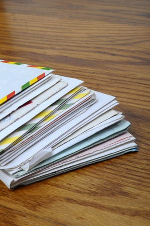 unpaid: Pile of old mails letters and envelopes on wooden table