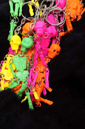 terrific: Colored halloween skeletons on black background