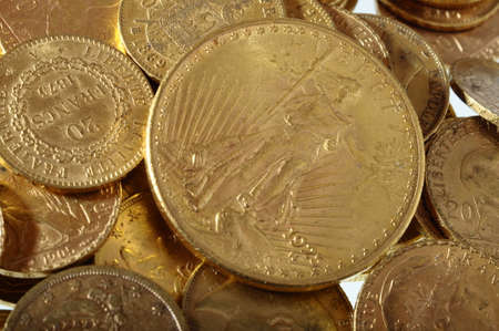 marianne: Close up of a stock of Gold french and american coins