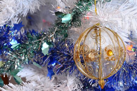 the tinsel: Close up of white christmas tree, christmas balls and tinsel