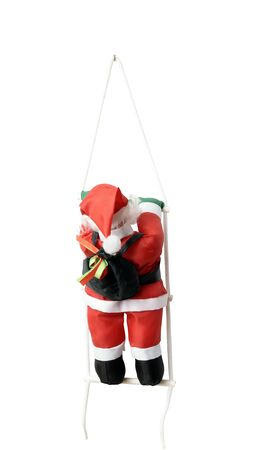 climbing ladder: Santas Claus climbing a ladder isolated on white background by clipping path Stock Photo