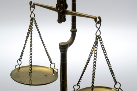 judgements: Old Golden weighing scale balance