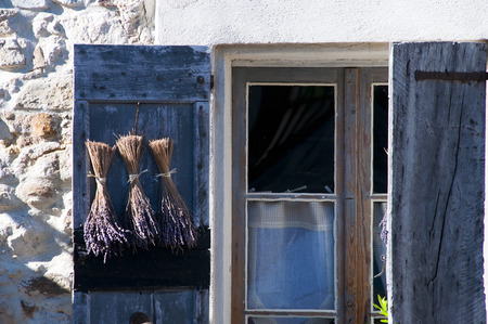 flap: Close up of window with blue flap and lavender drying in Provence, France Stock Photo
