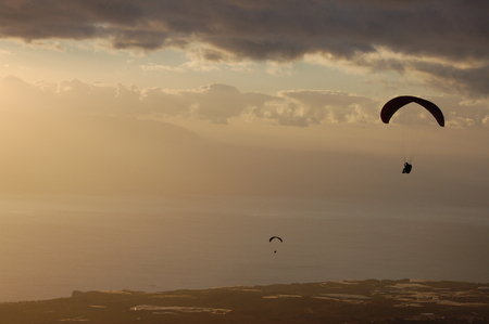 canaries: View of Paragliding backlit flying over coast of Tenerife, Canaries