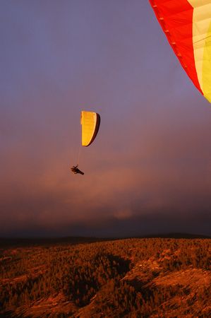 canaries: View of Paragliding backlit flying over mountain in Tenerife, Canaries Stock Photo