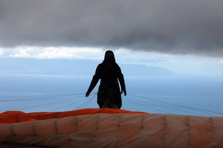 canaries: Woman at paragliding launch area in Tenerife, Canaries Stock Photo