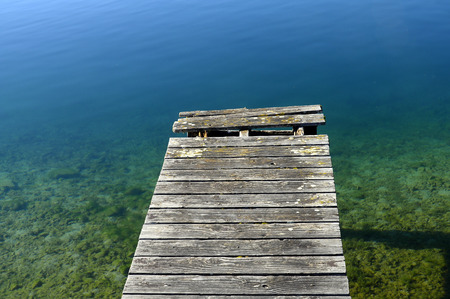 pontoon: Wooden pontoon and blue water on quiet Annecy lake, France