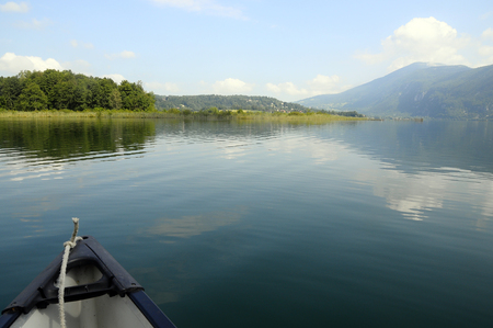 nautic: Canoe and landscape on Aiguebelette quiet lake, in Savoy, France
