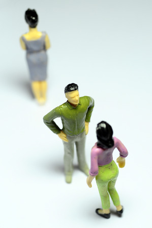 adultery: Miniature Man chatting with woman, and single woman turning back