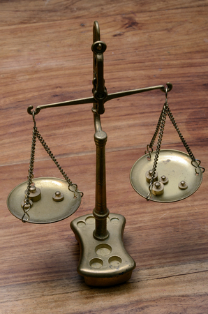 Old Golden weighing scale balance