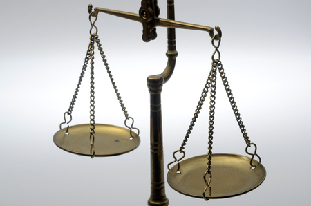 judgments: Old Golden weighing scale balance