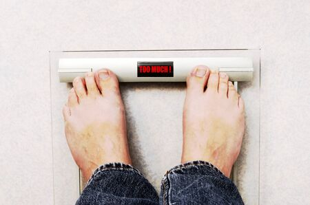 weighted: Feet on wheight balance and too much, too big, over weighted mention Stock Photo