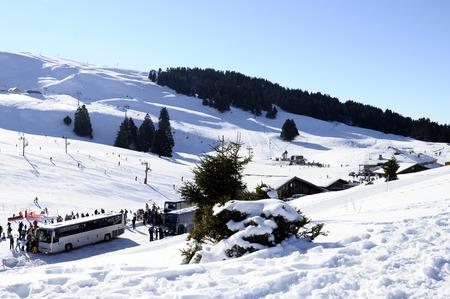 france station: Ski station of Semnoz, snow, bus and skiers, Savoy, France