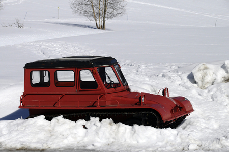 Red vintage snow plow or snowplough in snow, Plateau of Glieres, Savoy Stock Photo