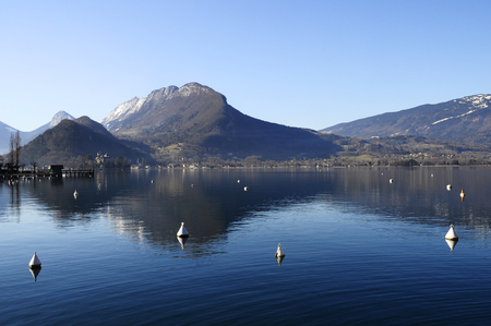 Annecy lake in Talloires, mountains with snow, winter landscape, Savoy, France Stock Photo
