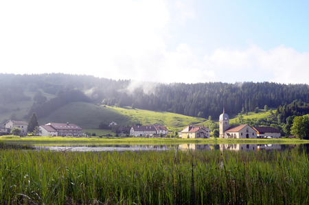 Large view of Abbaye lake and its abbey church, also known as Grandvaux lake, or Lake great river in Jura, France Stock Photo