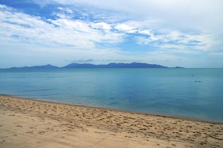 Beautiful and quiet sandy beach of koh samui island, in Thailand. View upon Koh phangan island.
