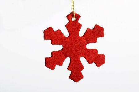 Red felt snow flake for christmas illustration or decoration