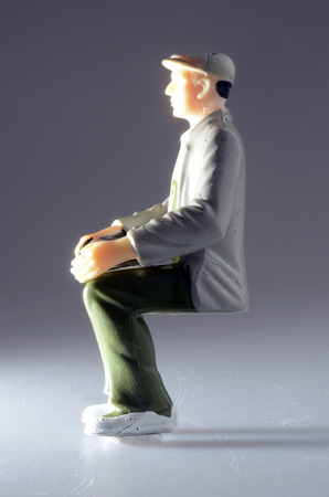 Seated man plastic figurine in the void