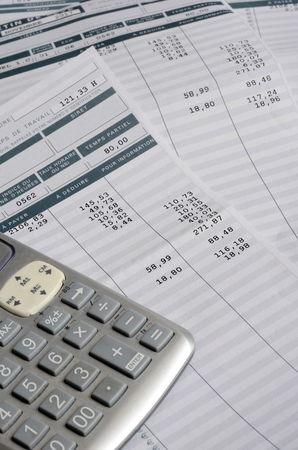 Euro Pay slip and calculator, close up for payroll or salary background, french mention Net to pay 写真素材
