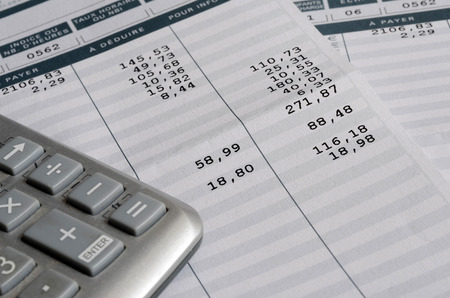 Euro Pay slip and calculator, close up for payroll or salary background, french mention Net to pay Stockfoto