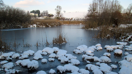 Snowed landscape and pond in Savoy, France