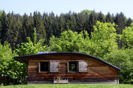 Wooden chalet with curved roof in Savoy, French Alps, France