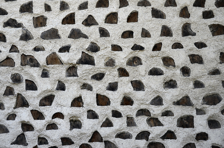 White walls and wooden piles, for texture or background, close up