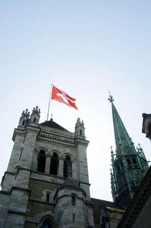 St. Pierre Cathedral and Swiss flag in Geneva, architecture of the city, alps, Swiss