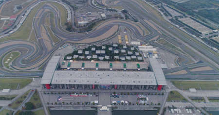 Shanghai, China - November, 16 2018: Empty Race track , Formula 1 Circuit with patron grandstand alongside. Concept of spectatorship for decisive sport moments. Empty board above an international racetrack. 新聞圖片