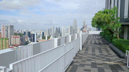 Beautiful rooftop garden,modern benches under green trees along walkway. Urban eco design and mini-ecosystem concept. Landscaping in Singapore. Outside terrace with scenic park and amazing city view