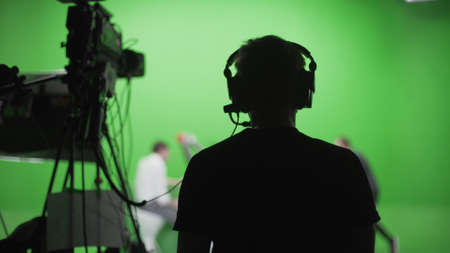 Film studio set: shooting green screen scene with chroma key. Period drama or action movie backstage. Film industry concept.