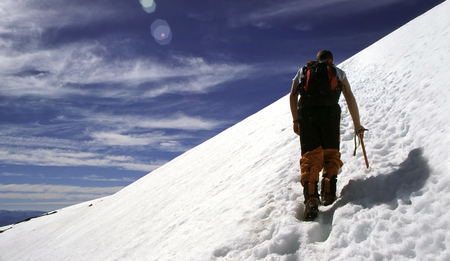 A man climbing up the Villarricca volcano in Chile